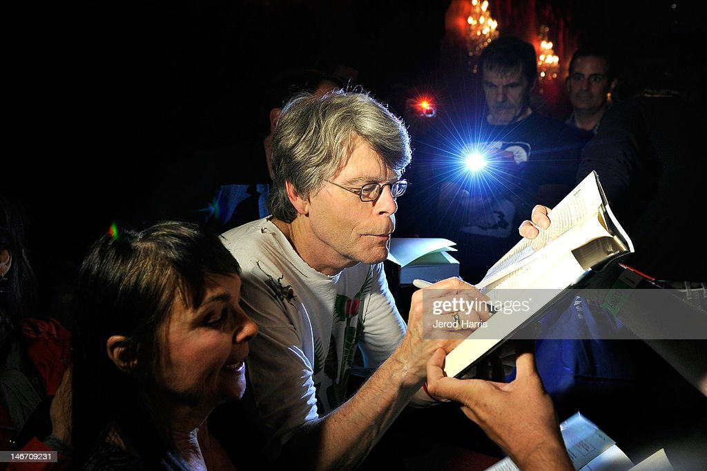 Author Stephen King signs autographs for fans prior to performing with the Rock Bottom Remainders at El Rey Theatre on June 22, 2012 in Los Angeles, California.