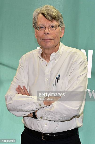 "Author Stephen King signs the copies of his book ""Revival"" at Barnes & Noble Union Square on November 11, 2014 in New York City."