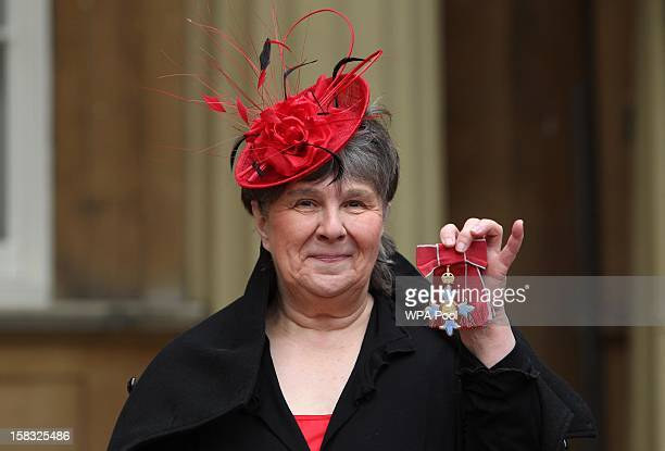 Author Susan Hill holds her Commander of the British Empire medal which was awarded to her by Queen Elizabeth II during an Investiture ceremony at...