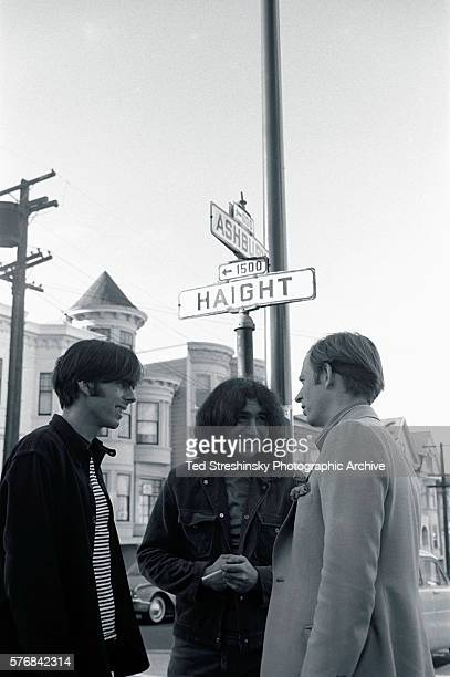 Author Tom Wolfe talks with Jerry Garcia of the Grateful Dead and the band's manager Rock Scully under the street signs on the corner of Ashbury and...