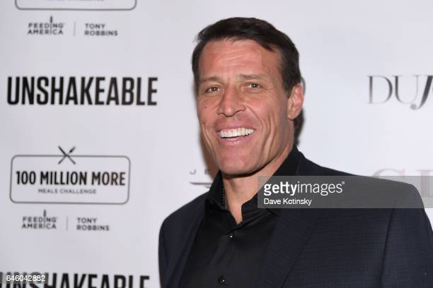 Author Tony Robbins attends Tony Robbins' Birthday celebration and book launch of 'UNSHAKEABLE' presented by DuJour Gilt and JetSmarter at PHD...