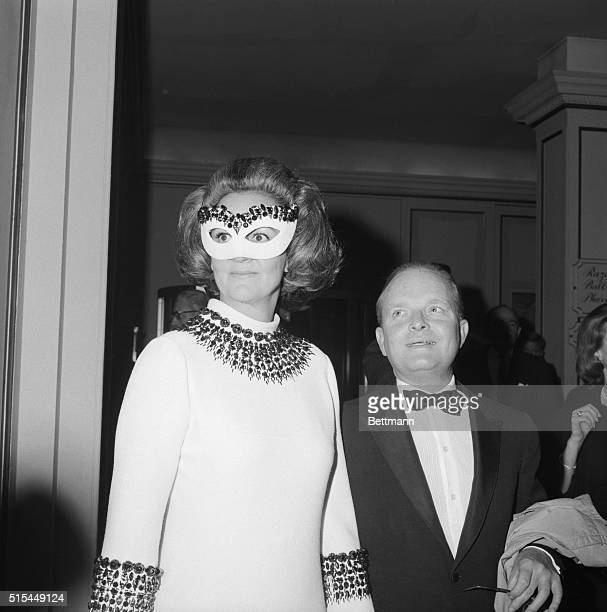 Author Truman Capote host of a private party for 450 arrives at the Hotel Plaza holding hands with Mrs Katherine Graham the guest of honor Mrs Graham...