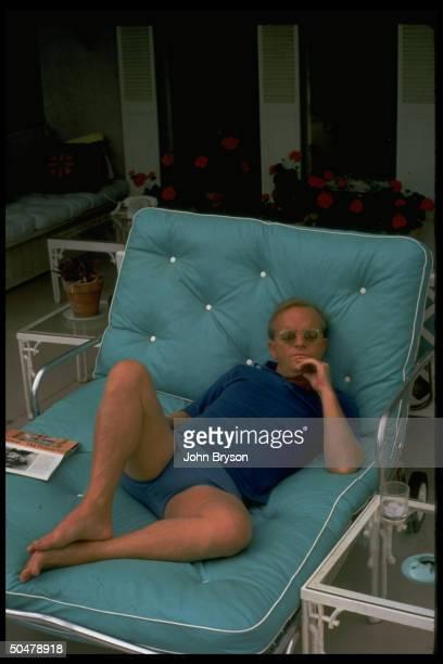 Author Truman Capote lounging in sun