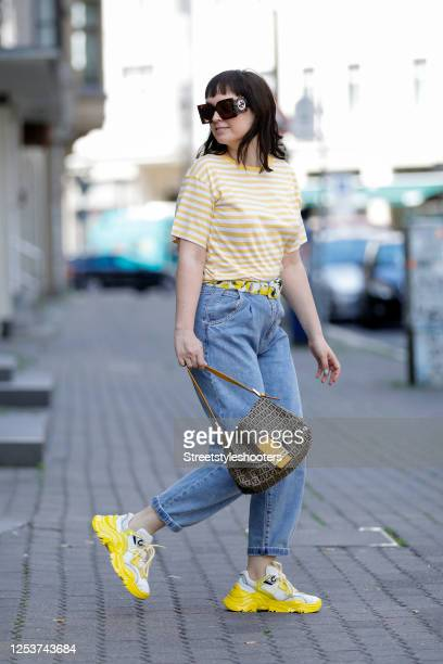 Author, TV host and influencer Vreni Frost, wearing a a yellow-white striped T-shirt by Second Hand, a denim Jeans by Mango, Yellow-white sneakers by...