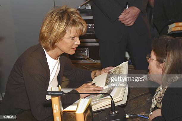 "Author Ushi Glas signs copies of her new book, ""Mit Einem Lacheln"" at the Thalia bookstore March 9, 2004 in Berlin, Germany. The book details her..."