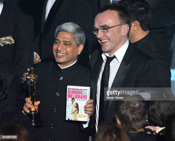 Author Vikas Swarup and director Danny Boyle celebrate Slumdog Millionaire winning the Best Picture award during the 81st Annual Academy Awards held...