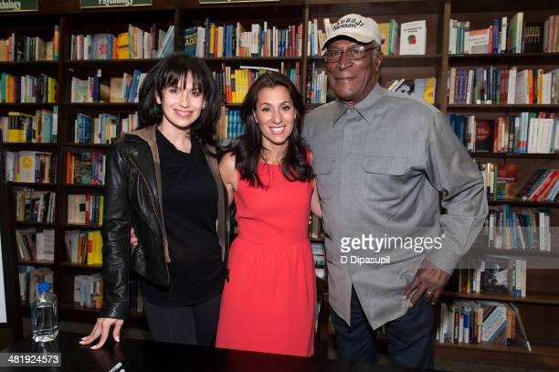 Author Yvette Manessis Corporon poses with Hilaria Baldwin and John Amos while promoting her book When the Cypress Whispers at Barnes Noble 82nd...