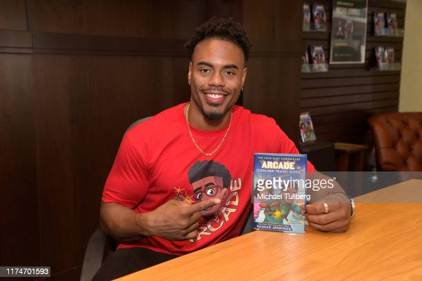 """Author/former NFL player Rashad Jennings attends a signing event for his new book """"Arcade and the Golden Travel Guide"""" at Barnes & Noble at The Grove..."""