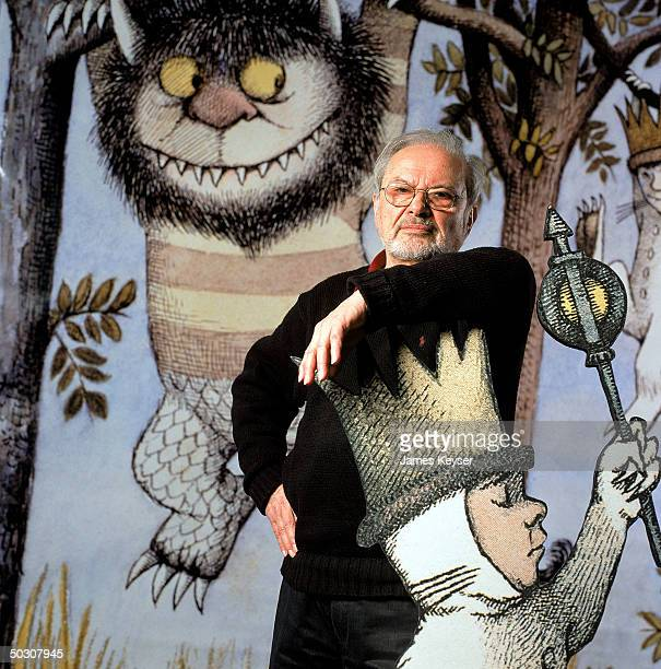 Author/illustrator Maurice Sendak standing by an lifesize scene from his book WHERE THE WILD THINGS ARE at the Children's Museum of Manhattan which...
