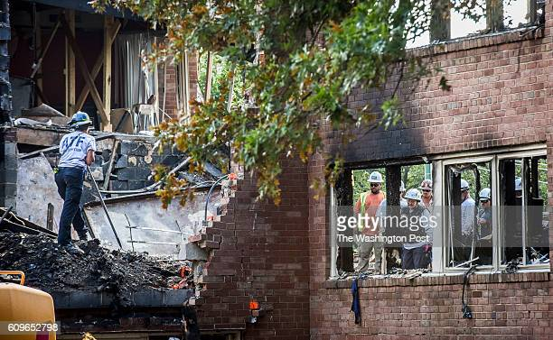 Authorities continue the search and cleanup at the scene of Friday night's explosion that devastated an apartment building on August 2016 in Silver...