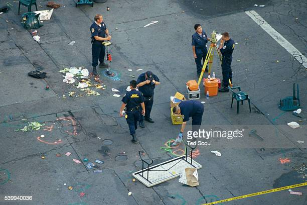 Authorities examine evidence at the site of the deadly Santa Monica Farmer's Market crash that killed 10 people and injured 63 others. George Russell...