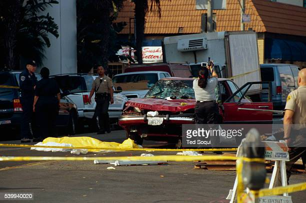 Authorities examine the Buick LeSabre driven by an older driver responsible for the deadly Santa Monica Farmer's Market crash that killed 10 people...
