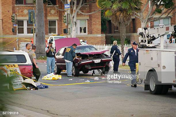 Authorities gather evidence from the Buick LeSabre at the site of the deadly Santa Monica Farmer's Market crash that killed 10 people and injured 63...