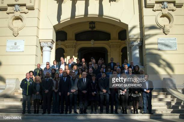 Authorities observe a minute of silence at the entrance of Malaga's city hall on January 26 2019 Spain grieved on today after a toddler who fell down...