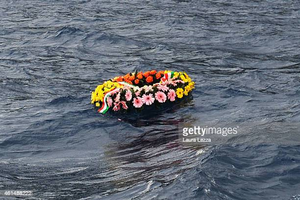 Authorities place a flower wreath into the sea at the site of the Costa Concordia Ship disaster on January 13 2015 in Isola del Giglio Italy Three...