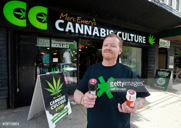 Authorized marijuana distributor John Berfelo stands outside Marc Emery's Cannabis Cafe as he holds two accredited child resistant packaging...