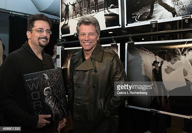 Author/Photographer David Bergman and Musician Jon Bon Jovi at Altman Building on November 12, 2014 in New York City.