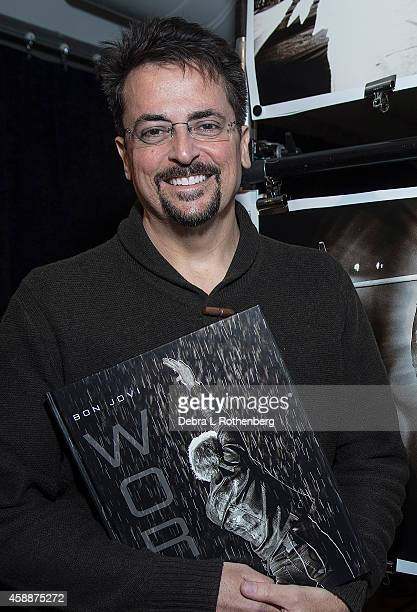"""Author/Photographer David Bergman signs copies of his new book """"Work"""" at Altman Building on November 12, 2014 in New York City."""