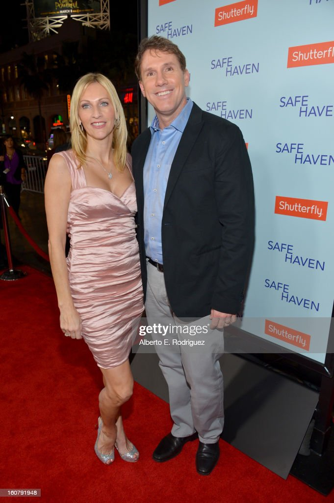 Author/producer Nicholas Sparks (R) and Cathy Sparks arrive at the premiere of Relativity Media's 'Safe Haven' at TCL Chinese Theatre on February 5, 2013 in Hollywood, California.
