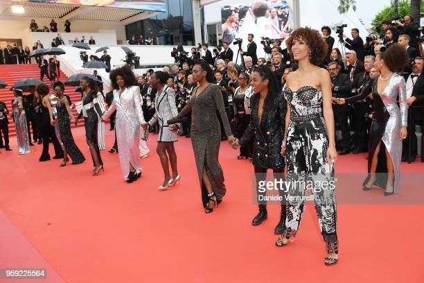 Authors of the book Noire N'est Pas Mon Métier attend the screening of Burning during the 71st annual Cannes Film Festival at Palais des Festivals on...