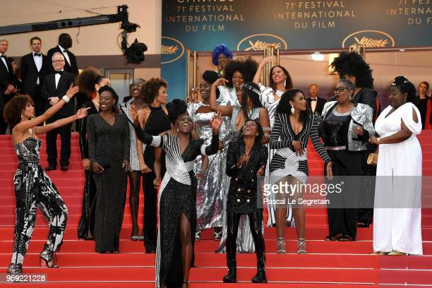 Authors of the book 'Noire N'est Pas Mon Métier' dance on the stairs at the screening of 'Burning' during the 71st annual Cannes Film Festival at...