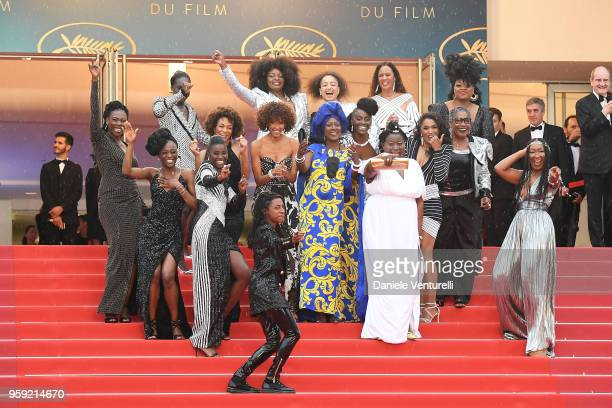 Authors of the book Noire N'est Pas Mon Métier pose on the stairs at the screening of Burning during the 71st annual Cannes Film Festival at Palais...