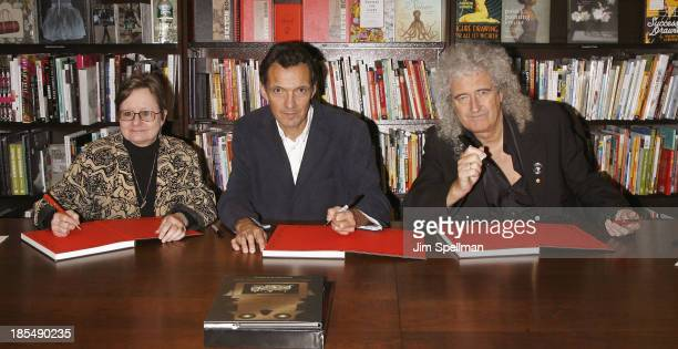 Authors Paula Fleming Denis Pellerin and musician/singer/ songwriter/ author Brian May sign copies of their book 'Diableries Stereoscopic Adventures...