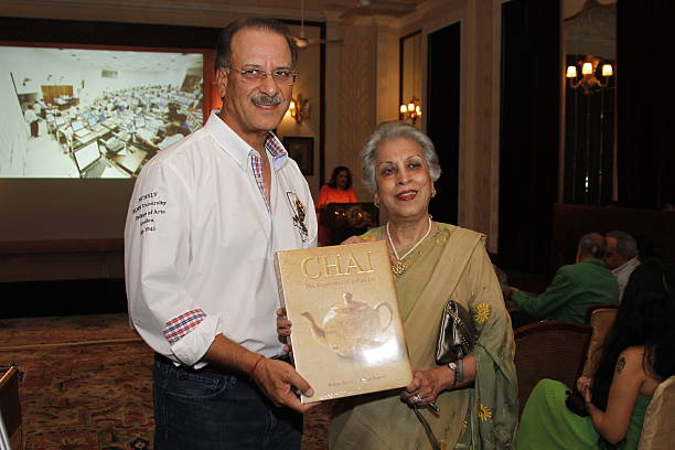 Authors Rekha Sarin and Rajan Kapoor pose with the copy of their book Chai The Experience of Indian Tea during its launch on April 21 2014 in New...