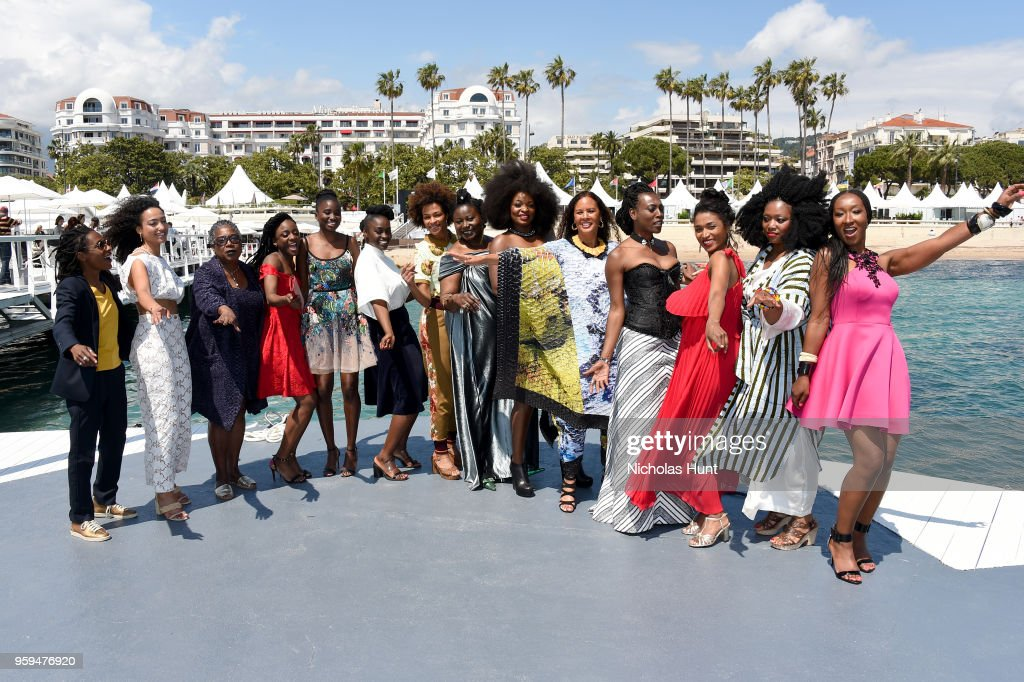 Authors Shirley Souagnon, Magaajyia Silberfeld, Firmine Richard, Assa Sylla, Karidja Toure, Aissa Maiga, Sonia Rolland, Marie Philomene Nga, Maimouna Gueye, France Zobda, Mata Gabin, Sara Martins, Sabine Pakora and Nadege Beausson-Diagne attend the 'My Profession Is Not Black' Photocall during the 71st annual Cannes Film Festival at Majestic Beach on May 17, 2018 in Cannes, France.