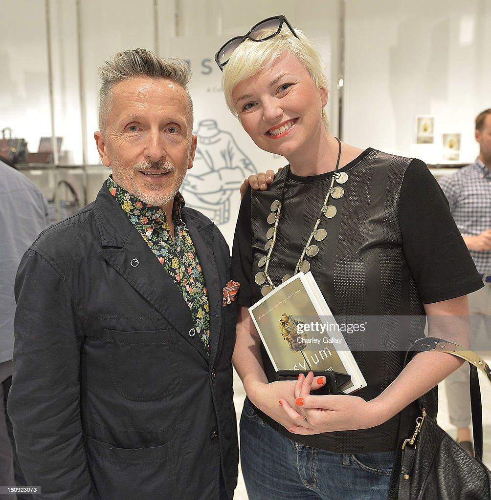 Authors Simon Doonan (L) and Leslie McKenzie attend Barneys New York Cocktail Event with Simon Doonan and 'Man Repeller' Leandra Medine at Barneys New York At The Grove on September 17, 2013 in Los Angeles, California.