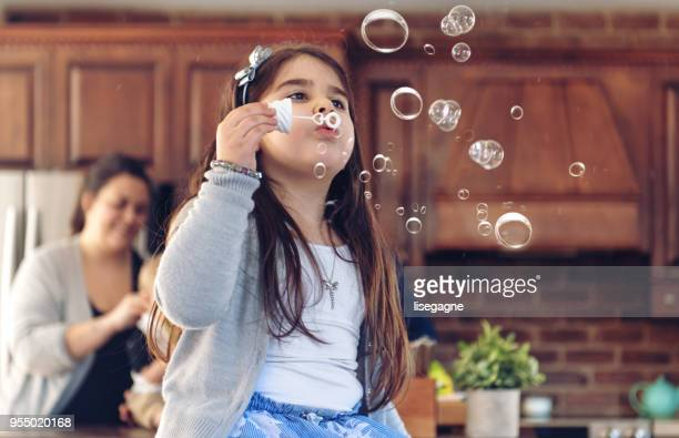 autism little girl playing with bubbles - bottomless girls stock pictures, royalty-free photos & images