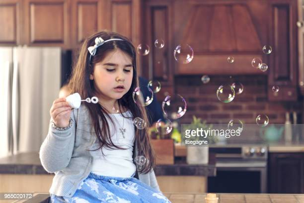 autism little girl playing with bubbles - bottomless girls stock photos and pictures