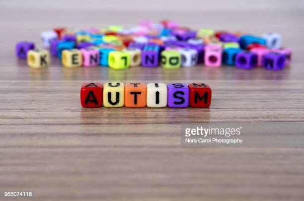 autism word and alphabet letter beads - autismo fotografías e imágenes de stock