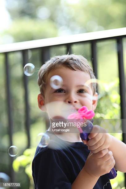 Autistic boy with bubble wand