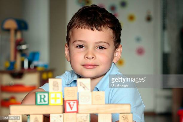 Autistic child with toy blocks