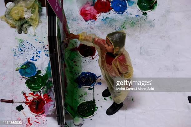 Autistic children paint a wall during the World Autism Awareness Day 2019 celebrations on April 2 2019 in Kuala Lumpur Malaysia More than 200...