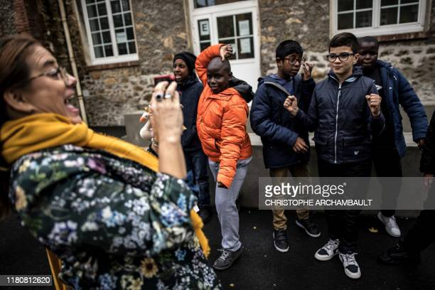Autistic children pose for a picture taken by a specialised teacher Caroline Berge at the College du Parc in Aulnay-sous-Bois, northeast of Paris on...