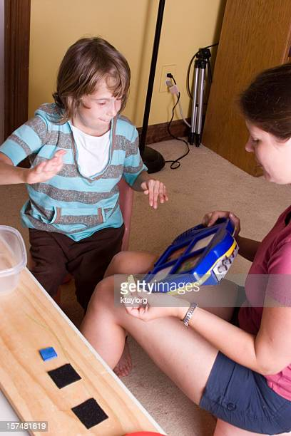 Autistic girl using communication device