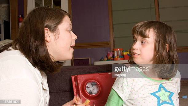 Autistic girl working with therapist