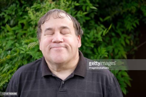 autistic man portraits - autism stock pictures, royalty-free photos & images