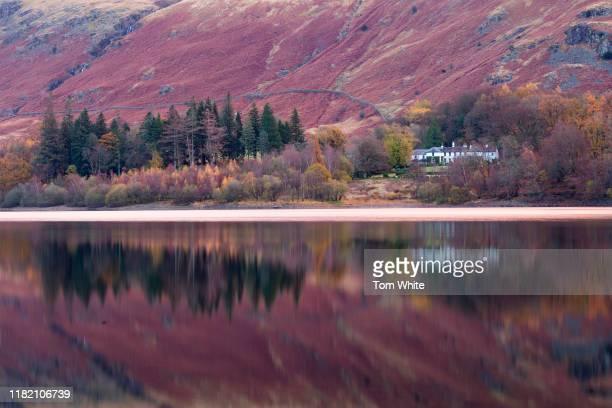 Autmnal colours are reflected in Thirlmere in the Lake District on November 13 2019 in Ambleside England Temperatures continue to drop across the UK...
