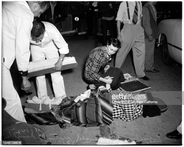 Auto accident at Ventura Boulevard at Sherman Oaks 24 March 1952 Mrs Cornelia Grunewald victim on streetMrs Claire Jones her daughter comforting her...