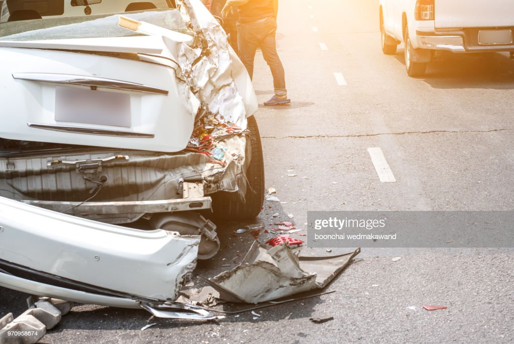 Auto accident involving two cars on a city street : Stock Photo