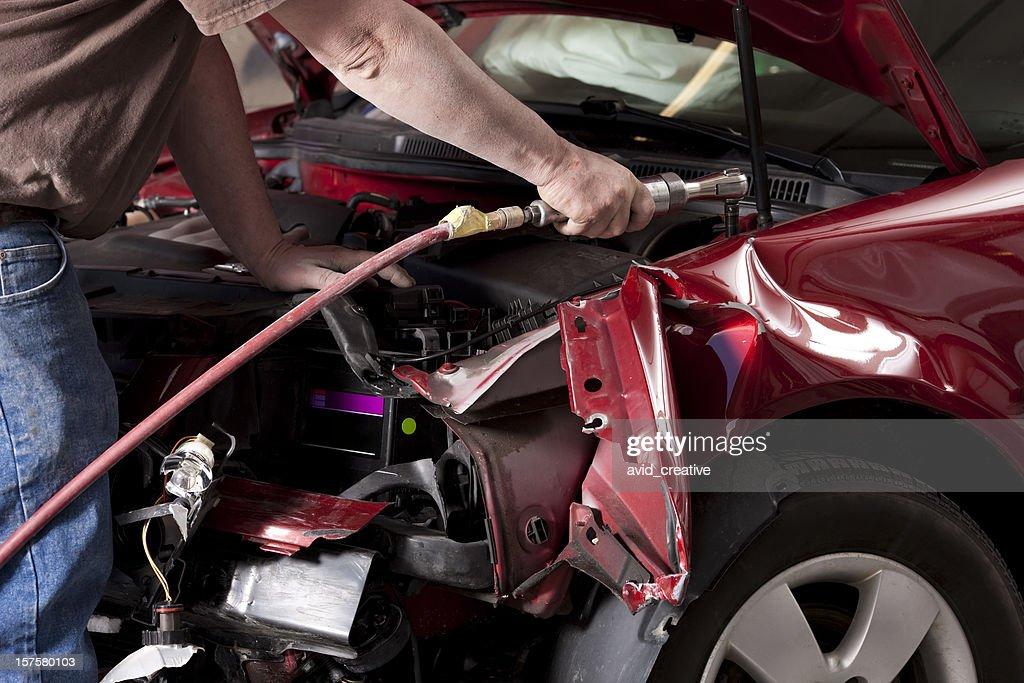 Auto Body Mechanic Disassembling Damaged Vehicle : Stock Photo