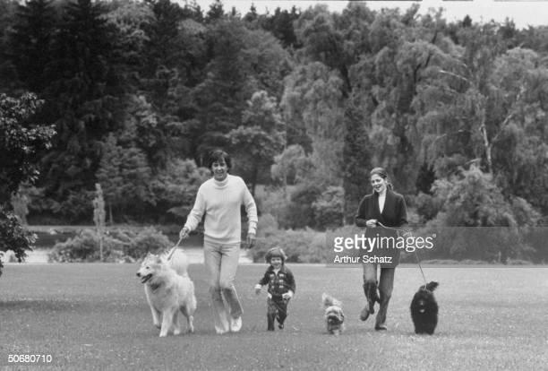 Auto designer John Z DeLorean walking his dogs with his wife Max Factor model Cristina Ferrare and their son Zachary