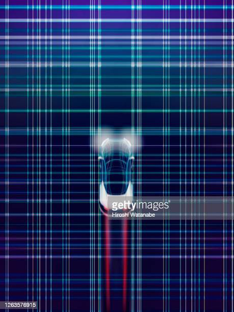 auto driving smart car in cyber space made of light trail - autonomous technology stock pictures, royalty-free photos & images
