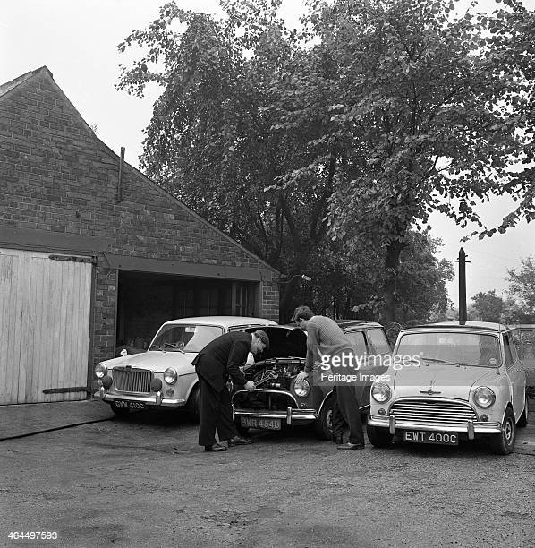 Auto Improvements Mexborough South Yorkshire 1965 Pat Wagstaff behind his car workshop in Mexborough during the summer of 1965 He seems to be using a...