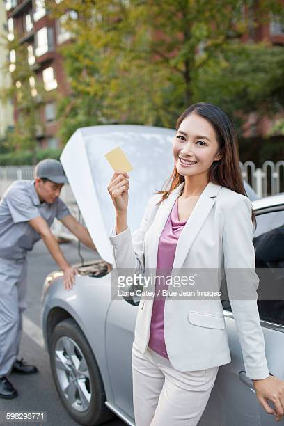 Auto mechanic and car owner