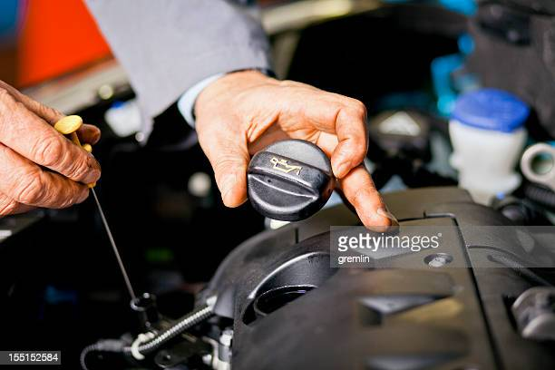 auto mechanic checking oil level - oil change stock pictures, royalty-free photos & images