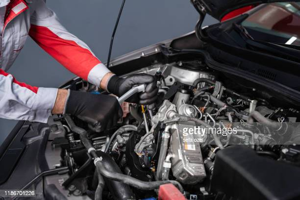 auto mechanic disassembling the engine in the car - dismantling stock pictures, royalty-free photos & images